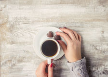 Hot coffee in the hands of a loved one. Royalty Free Stock Photography