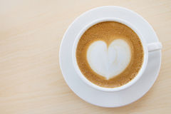 Hot coffee with heart pattern in white cup Stock Images