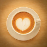 Hot coffee with heart pattern in white cup Royalty Free Stock Image