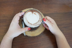 Hot coffee with heart shape coffee foam Royalty Free Stock Photos