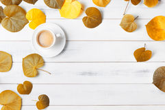 Hot coffee with heart shaped autumn leaf Royalty Free Stock Photo
