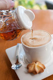 Hot coffee and honey Royalty Free Stock Image