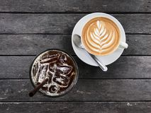 Hot coffee and Iced coffee on wood table , top view Stock Photos