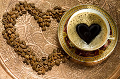 Hot Coffee In A Cup And Grains Royalty Free Stock Photo