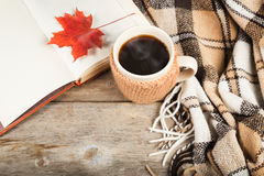 Hot coffee in a large cup, book, maple leaf, plaid Stock Image