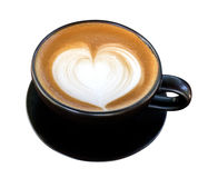 Hot coffee latte art heart shape foam in black ceramic cup isola Stock Photo