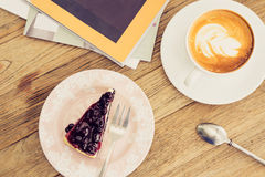 Hot coffee latte with blue berry cheese cake leisure lifestyle o Royalty Free Stock Photos