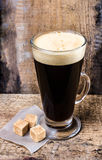 Hot coffee in a Latte Glass and sugar on Old wooden table or gru Royalty Free Stock Photography