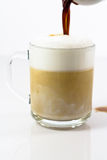 Hot coffee latte in a glassy cup. Preparing Royalty Free Stock Images