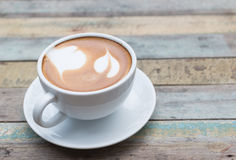 Hot coffee latte on grunge background Royalty Free Stock Image