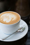 Hot coffee latte, latte art with heart in a white cup Royalty Free Stock Photo