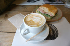 Hot coffee latte with sandwiches Royalty Free Stock Photography