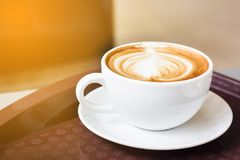 Hot coffee latte on white plate with copy space. Royalty Free Stock Photo