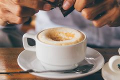 Hot coffee Latte with withe cup. Vintage tone Royalty Free Stock Photo
