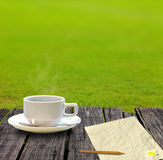 Hot coffee and letter paper on the wooden table Stock Photography