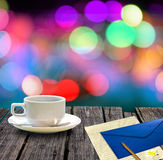 Hot coffee and letter on table Stock Images