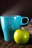 Hot Coffee in Light Blue cup and apple Stock Image