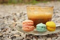 Hot coffee with macaron on the coasters. Royalty Free Stock Photography