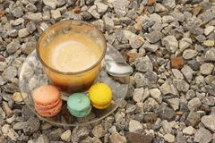 Hot coffee with macaron on the coasters. Royalty Free Stock Photos