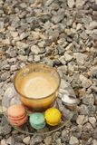 Hot coffee with macaron on the coasters. Royalty Free Stock Photo