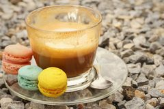 Hot coffee with macaron on the coasters. Stock Photography