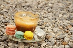 Hot coffee with macaron on the coasters. Stock Images