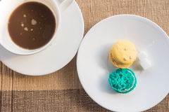 Hot coffee and macarons Royalty Free Stock Image