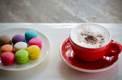 Hot coffee and macaroons. Cup of hot coffee and macaroons Stock Photography