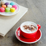 Hot coffee and macaroons. Cup of hot coffee and macaroons Royalty Free Stock Photo