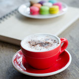 Hot coffee and macaroons. Cup of hot coffee and macaroons Royalty Free Stock Image