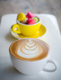 Hot coffee and macaroons. Cup of hot coffee and macaroons Royalty Free Stock Photos