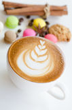 Hot coffee and macaroons. Cup of hot coffee and macaroons Royalty Free Stock Photography