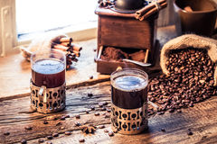 Hot coffee made of grinding grains Royalty Free Stock Images