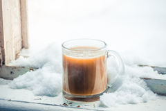 Hot coffee with milk in a glass mug Stock Photo