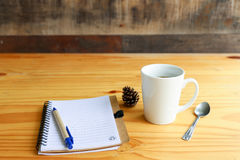 Hot coffee with mobile phone on the wood table Royalty Free Stock Image