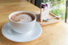 Hot coffee mocha with foam milk. And blueberry cake in countryside cafe Stock Images