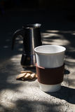 Hot coffee and moka pot with biscuits Royalty Free Stock Photography