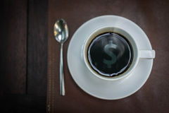 Hot coffee with money sign reflex on top, business concept Stock Photos