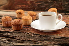 Hot coffee and muffins. . Stock Image