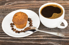 Hot coffee and muffins in saucer on table Royalty Free Stock Photo
