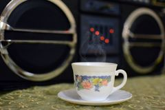Relaxing. Cup of coffee & music player Royalty Free Stock Photos
