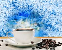 Hot coffee near frozen window Stock Images