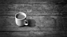Hot coffee on old wooden plank in low key black and white style stock images