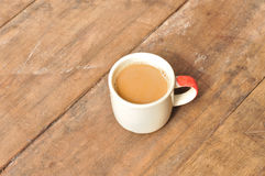 Hot coffee on old wooden plank stock photos