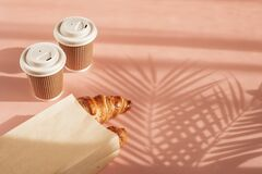 Free Hot Coffee On The Go And Croissants For Breakfast. Biodegradable, Disposable Takeaway Cups Stock Photo - 215275680