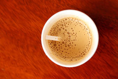 Hot coffee in paper cup seen from top Stock Photo