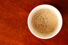 Hot coffee in paper cup seen from top Royalty Free Stock Images