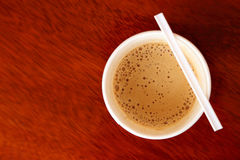 Hot coffee in paper cup seen from top Stock Image