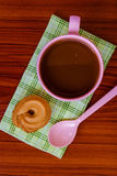 Hot coffee in pink cup. With cookies and spoon on cloth Stock Photo