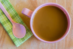 Hot coffee in pink cup. And spoon on cloth Royalty Free Stock Image